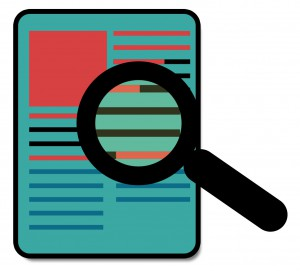 Image of magnifying glass over document