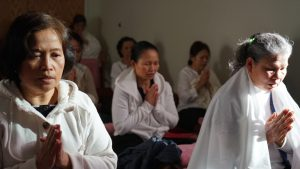 cambodian-women praying in Culturally competent care setting