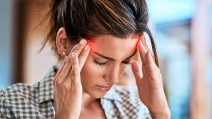 A woman with a headache because of pain points in translation