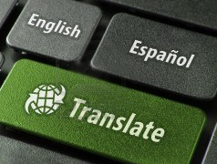 A keyboard with keys for English, Español and Translate