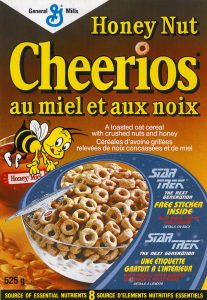 A box of Honey Nut Cheerios with bilingual packaging in English and French showing French Translation for Food Packaging for Canada
