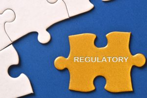 """Puzzle piece that says """"REGULATORY"""""""